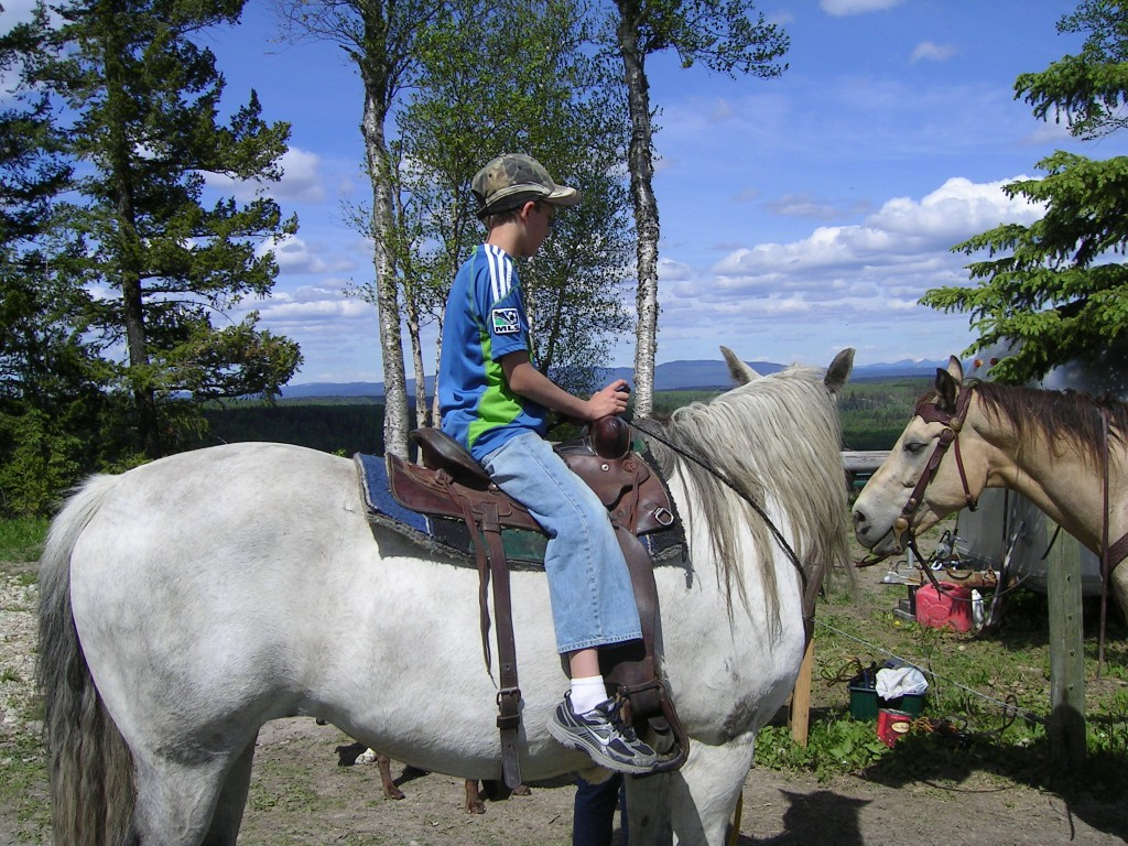 Michal on horseback at the ranch.